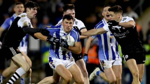 Branagan brothers Eugene (left) and Aaron (right) challenge Ballyboden's Colm Basquel in the All-Ireland Club semi-final earlier this month