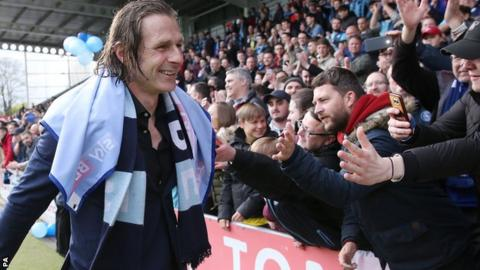 Gareth Ainsworth celebrates League Two promotion with Wycombe fans