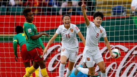 Wang Shanshan (right) celebrates scoring for China against Cameroon