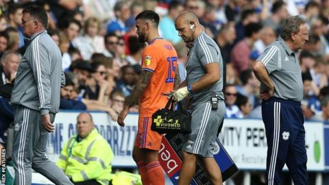 Cardiff midfielder Marlon Pack leaves the field injured in last Sunday's loss at Reading