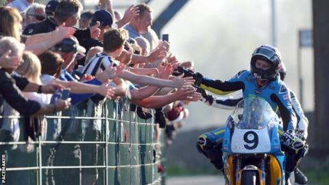 David Johnson celebrates his Superbike victory with spectators on the Isle of Man