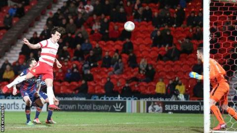 Doncaster's John Marquis heads in his first goal