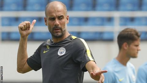 Pep Guardiola takes Manchester City training during their tour of China