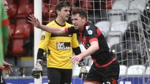 Delight for Billy Joe Burns after he puts Crusaders 2-1 in front against Glentoran at Seaview