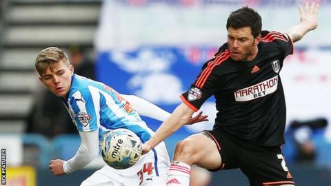 Jake Charles (left) in action for Huddersfield Town against Tim Hoogland of Fulham in 2015