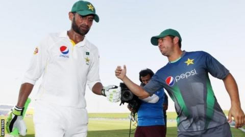 Pakistan's Shoaib Malik is congratulated