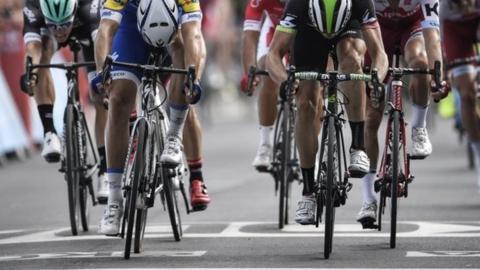 Marcel Kittel and Edvald Boasson Hagen cross the finish line