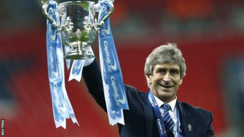 Manuel Pellegrini celebrates winning the Capital One Cup