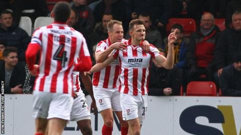 Will Boyle celebrates opening the scoring for Cheltenham Town