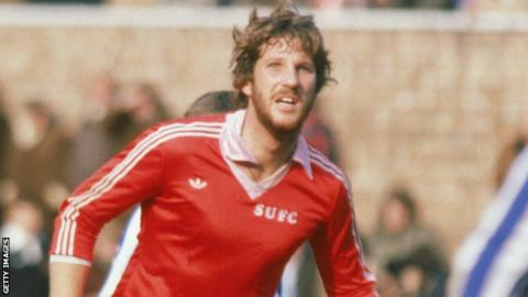 Sir Ian Botham plays for Scunthorpe against Wigan in March 1980