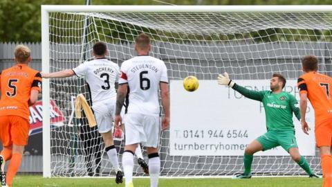 Mark Docherty scores