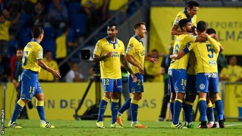 Las Palmas players celebrate scoring against Real Madrid