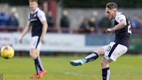 Declan McManus scores