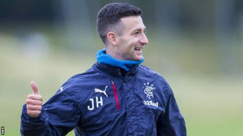 Rangers midfielder Jason Holt gives the thumbs up during training