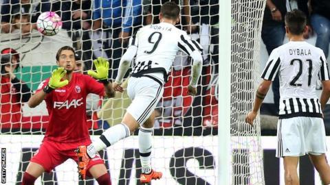 Alvaro Morata heads a goal for Juventus