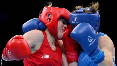 Michaela Walsh trades blows with Russia's Elena Saveleva in Saturday's bout