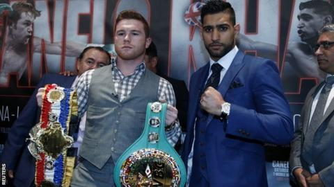 """Saul """"Canelo"""" Alvarez and Amir Khan pose during the press conference"""