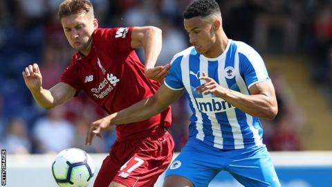 Nathaniel Phillips of Liverpool and Jordan Archer of Chester FC vie for the ball