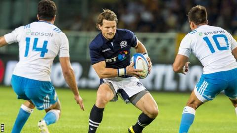Peter Horne playing for Scotland against Italy