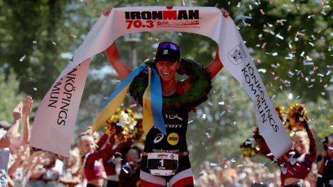 JONKOPING, SWEDEN - JULY 08: Lisa Norden of Sweden celebrates winning the women's race at Ironman 70.3 Jonkoping on July 8, 2018 in Jonkoping, Sweden. (Photo by Nigel Roddis/Getty Images for IRONMAN)