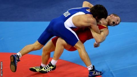 Vasyl Fedoryshyn (right) of Ukraine competes in the men's 60kg freestyle wrestling gold medal match in 2008