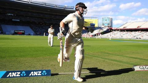 Henry Nicholls runs off as New Zealand declare