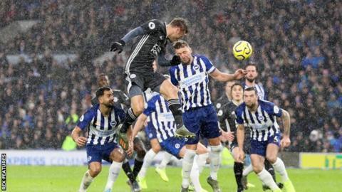 Jamie Vardy heads towards the Brighton goal