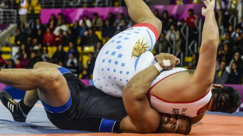 Lima, Peru, 8 August: Argentina's Luciano del Rio, top, and Chile's Yasmani Acosta compete in the bronze repechage of the men's 130kg Greco-Roman wrestling competition at the Pan-American Games. (Ernesto Benavides/AFP/Getty Images)