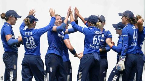Beth Langston (third left) celebrates a wicket