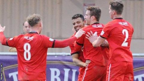 Isaac Vassell is congratulated by his teammates after his late equaliser for Truro