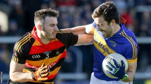 Maghery's Aidan Forker is challenged by Cullyhanna's Sean Connell