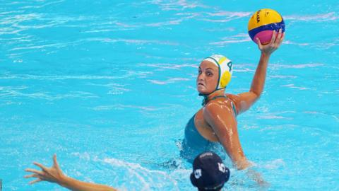 GWANGJU, SOUTH KOREA - JULY 26: Bronte Halligan #4 of Australia takes a shot against Natasa Rybanska #5 of Hungary during the Women's Water Polo Bronze Medal match on day 14 of the Gwangju 2019 FINA World Championships at Nambu University on July 26, 2019 in Gwangju, South Korea. (Photo by Maddie Meyer/Getty Images)