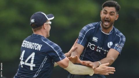 Safyaan Sharif celebrates taking England's final wicket