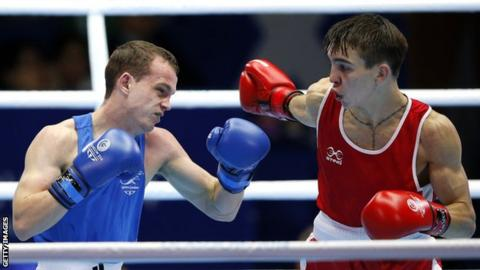 Wales' Sean McGoldrick fights Northern Ireland's Michael Conlan in their 2014 Commonwealth Games semi-final in Glasgow