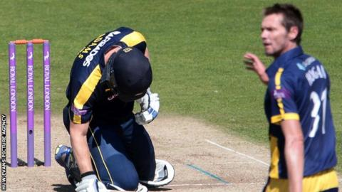 Glamorgan's Michael Hogan (right) looks on after his delivery hits Hampshire's Jimmy Adams