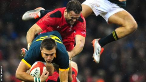 Wales centre Jamie Roberts tackles Handre Pollard of South Africa