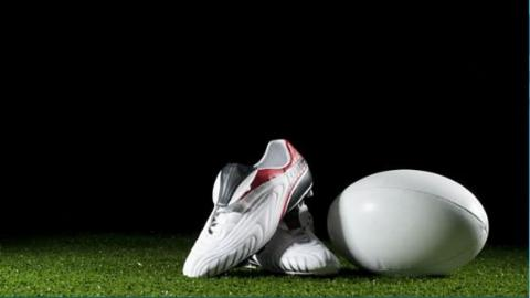 Rugby league ball and boots