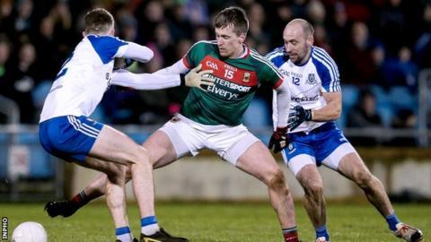 Mayo's Cillian O'Connor in action against Fintan Kelly and Gavin Doogan