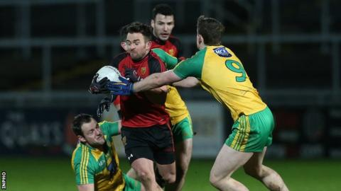Down's Mark Poland in action against Hugh McFadden of Donegal