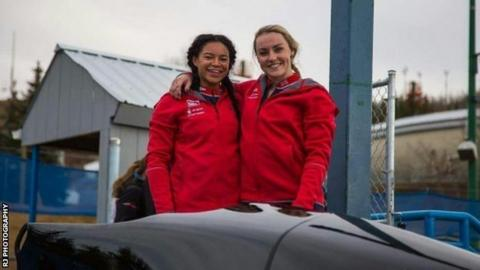 Mica Moore with a bobsleigh