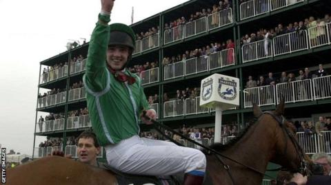 Ruby Walsh riding Papillon celebrates after victory in the 2000 Grand National at Aintree race course