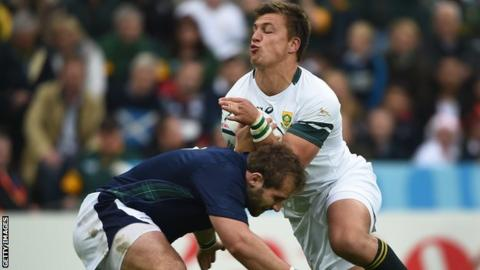 Scotland hooker Fraser Brown tackles South Africa fly-half Handre Pollard at the 2015 World cup