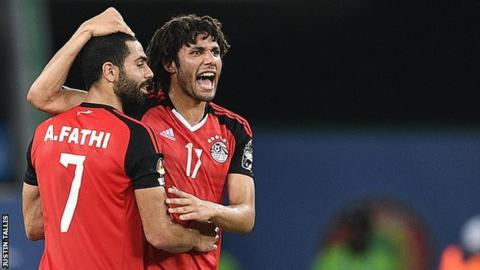Egypt defender Ahmed Fathi (left) and midfielder Mohamed Elneny celebrate victory over Ghana