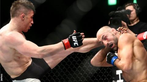 Norman Parke connects with Reza Madadi in their Dublin fight