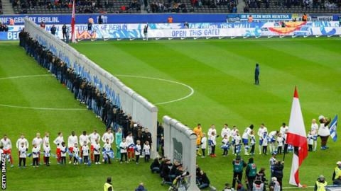 A replica of the Berlin Wall was knocked down on the pitch before Hertha Berlin's 4-2 defeat by RB Leipzig