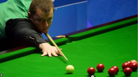 Mark Allen plays a shot during his quarter-final against Kyren Wilson in Sheffield