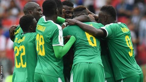 Senegal's players celebrate a goal