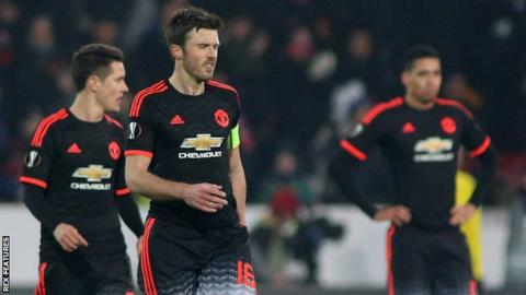 Michael Carrick (centre) and team-mates in Denmark