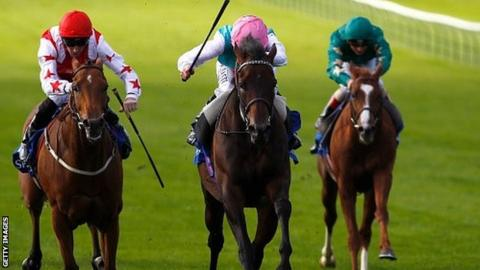 Ryan Moore on Time Test (pink cap) at Newmarket