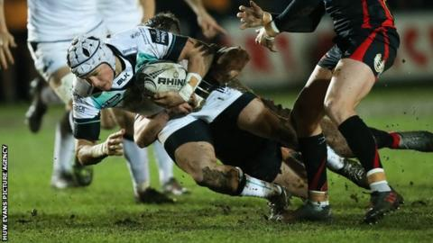 Hanno Dirksen of Ospreys takes on Angus O'Brien of Newport Gwent Dragons